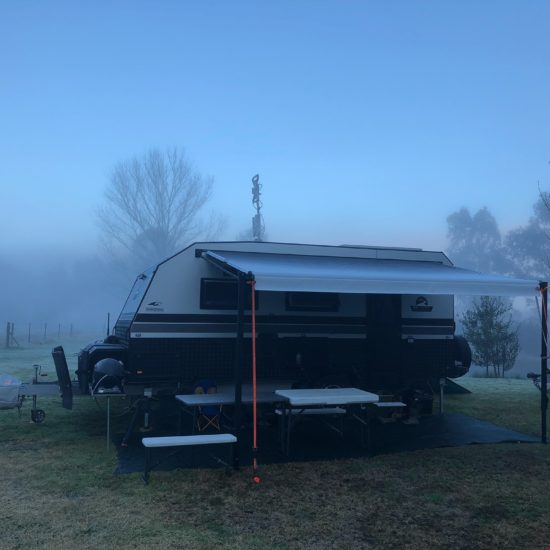 WHITE GREAT ESCAPE CARAVAN ON FOGGY MORNING AT DARTMOUTH